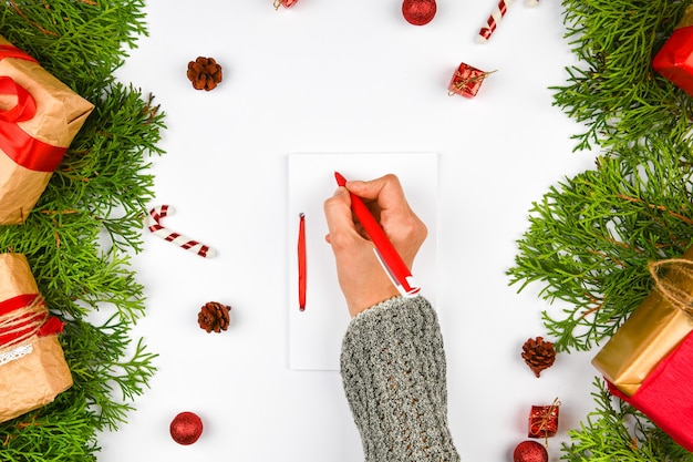 Dreams of goal plans make a list for writing a new year's christmas concept in a notebook