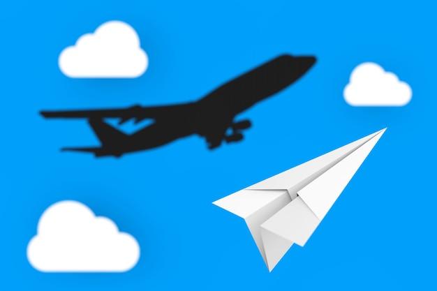 Мечты летать. белый бумажный самолетик оригами с тенью реактивного самолета пассажиров на фоне пасмурного голубого неба. 3d рендеринг