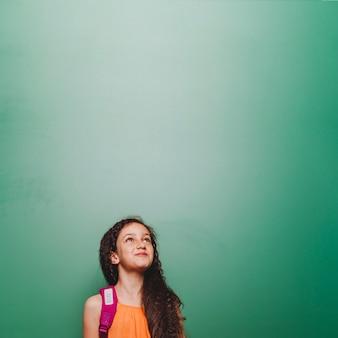 Dreamy girl at blackboard