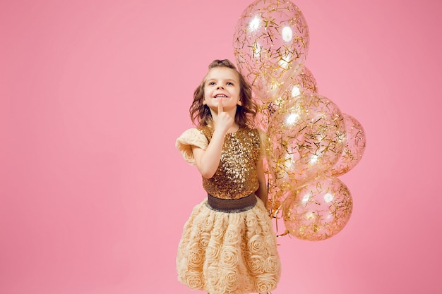 Dreamy little girl with balloons