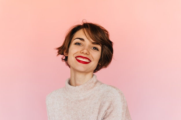 Dreamy short-haired woman looking at front