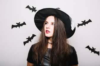 Dreamy witch girl in bats
