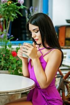 Dreamy woman sitting in a cafe. woman drinking latte