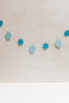 Dreidel and stars collection on the wall