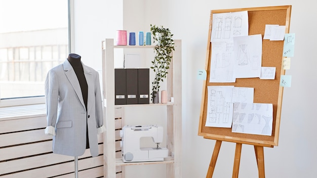 Dress form with blazer and idea board in atelier
