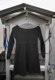 Dress hanging in dry cleaner's workshop
