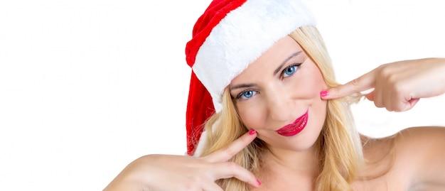 サンタクロースにdressしたブロンドの女の子