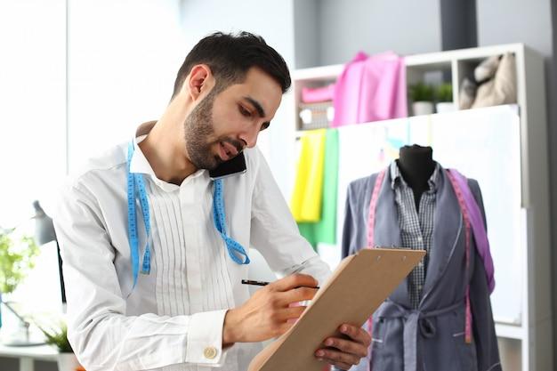 Dressmaking design service worker talking phone