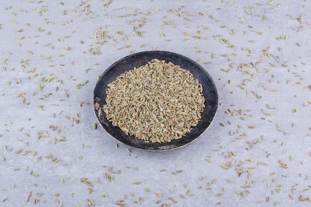 Dried anise seeds on a platter on concrete background. high quality photo