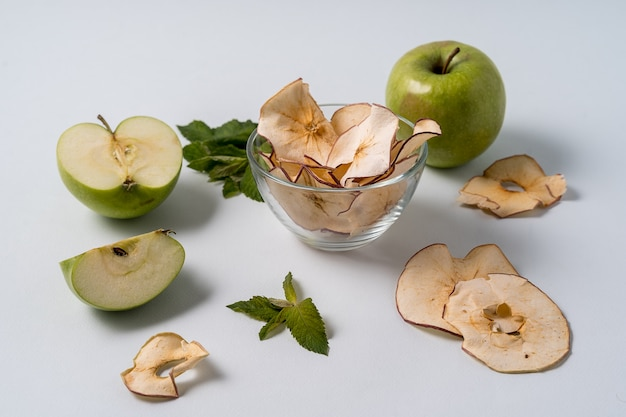 Dried apple chips and fresh apples.