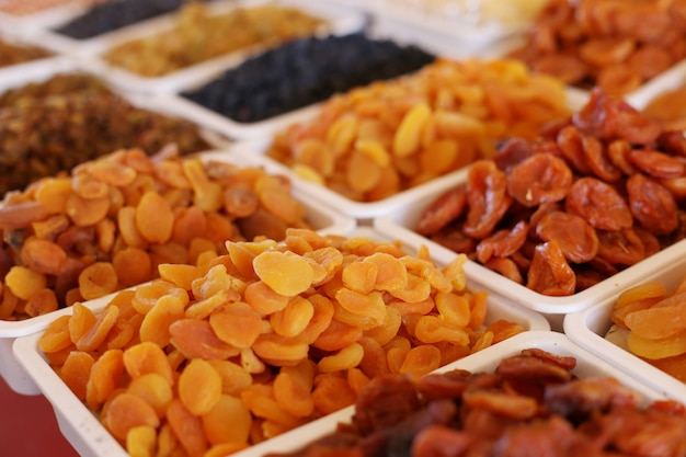 Dried apricots, dried fruits, on the market counter.