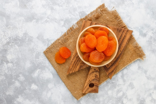 Dried apricots on light concrete
