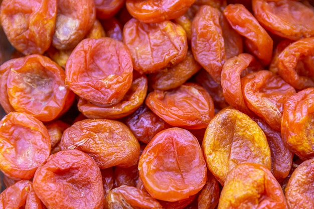Dried apricots in the store, closeup. background. space for text.