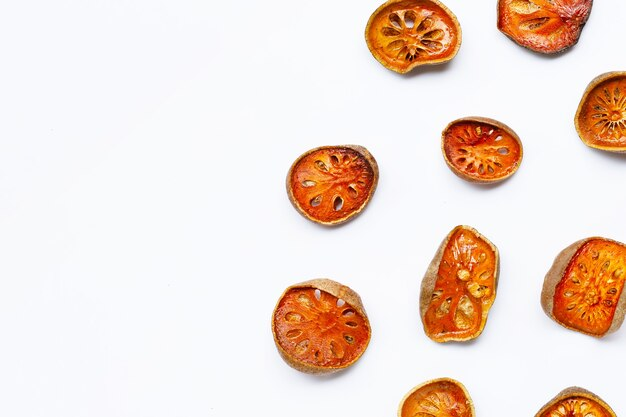 Dried bael fruit on white background