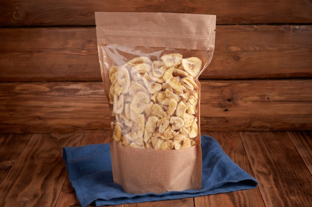Dried banana chips in craft eco packaging