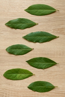Dried bay leaves laid out on the table top view spices