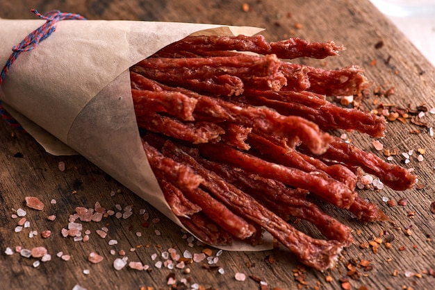 Dried beef and pork meat slices with spices and herbs