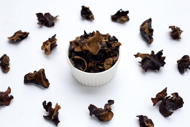 Dried black fungus on white background.