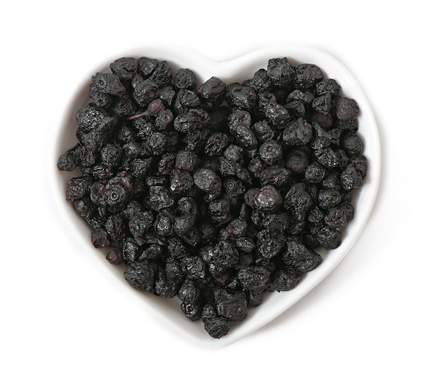 Dried blueberries in the shape of a heart isolated on