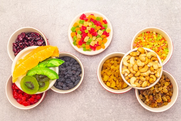 Dried and candied fruit and cashew nuts in ceramic bowls
