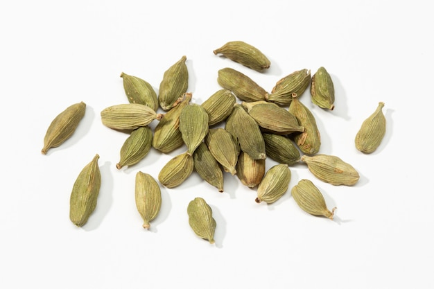 Dried cardamom seeds isolated on white . elettaria cardamomum