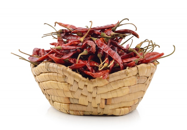 Dried chili in the basket on white background