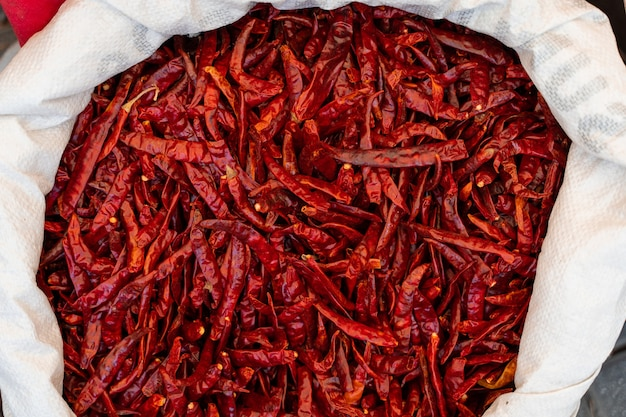 Dried chili peppers in bag at turkish market. hot red pepper.
