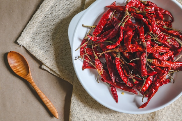 Dried chilli, red pepper in a white dish, ready to cook, food