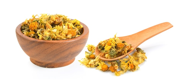 Dried chrysanthemum flowers inj wood bowl and spoon on white background