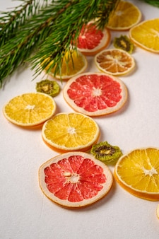 Dried citrus fruit slices with fir tree branch