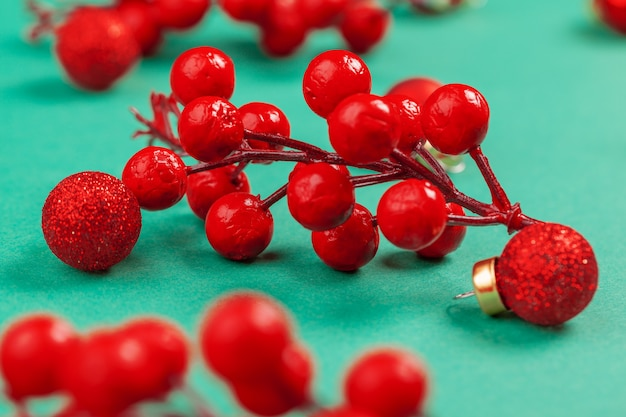 Dried cranberry decoration on green background for christmas