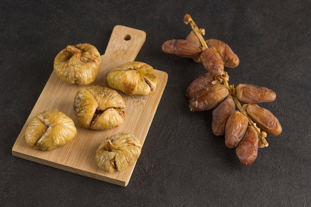 Dried dates and figs nutritious snack for weight loss. black background
