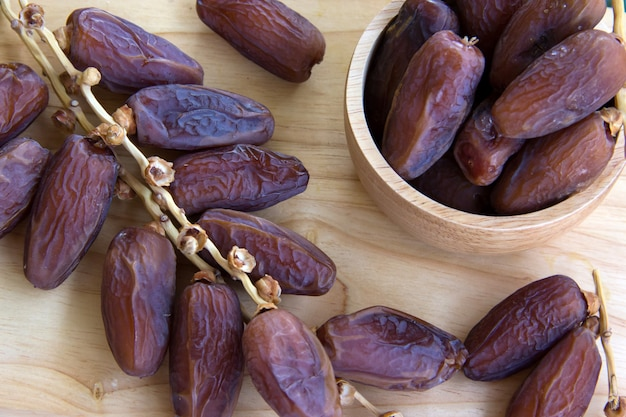 Dried dates fruit on wooden table, high energy fruit full of nutrition, good for pregnant