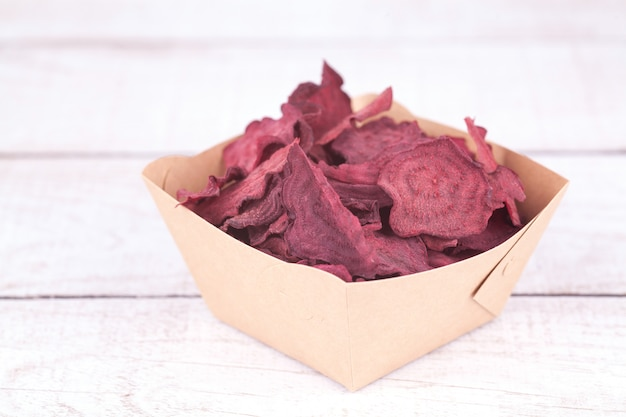 Dried dehydrated beet chips in craft bowl. delicious organic eco-friendly snack for the whole family. healthy eating concept.