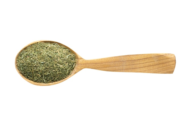 Dried dill for adding to food. spice in wooden spoon isolated on white. seasoning of delicious meal.
