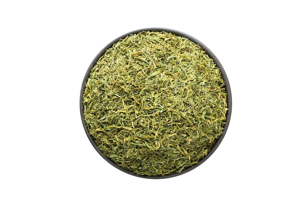Dried dill in clay bowl isolated on white background. seasoning or spice top view