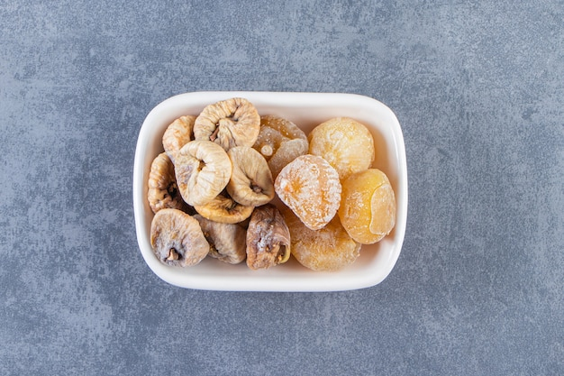 Dried figs in a bowl , on the marble background.