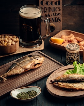 Dried fishes and glass of beer