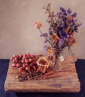 Dried flowers in glass vase with still life