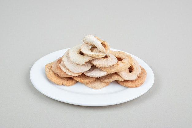 Dried fruit slices on white plate