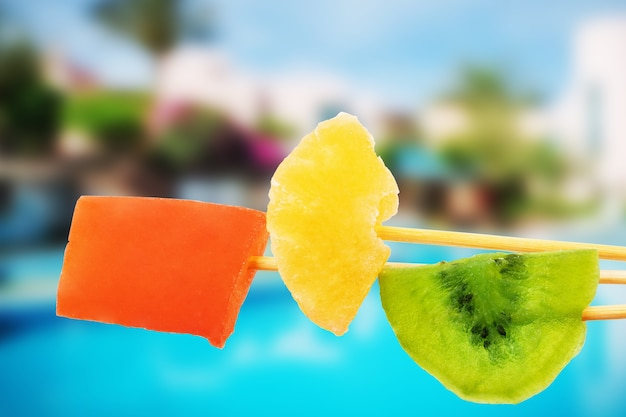 Dried fruits against the background of the pool and the beach, rest