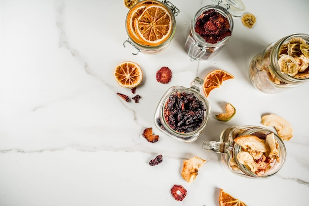 Dried fruits and berries in glass jars