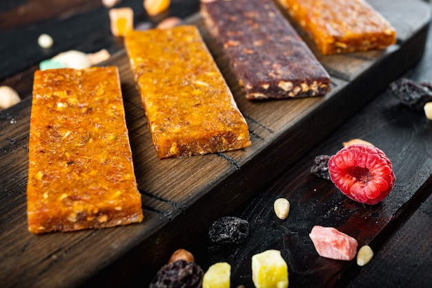 Dried fruits energy bars, on wooden table