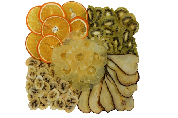 Dried fruits orange, kiwi, pear, pineapple and banana on a white background