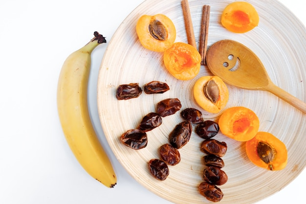 Dried fruits on white background. ingredients for the preparation of a sweet neck.