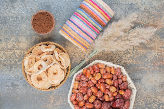 Dried fruits in wooden bowl on marble background.high quality photo