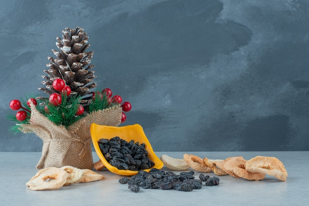 Dried healthy fruits with christmas red balls and wreath . high quality photo