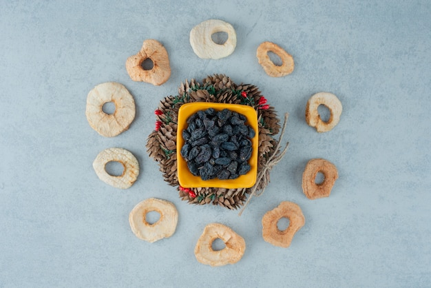 Dried healthy fruits with christmas wreath from pinecones. high quality photo
