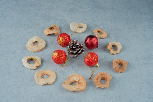 Dried healthy fruits with pinecones and christmas balls. high quality photo