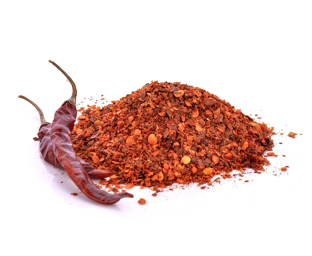 Dried hot chilli peppers against a white background